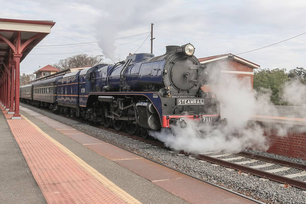 R-711 Steam Train with passenger carriages at Castlemaine railway Station AU
